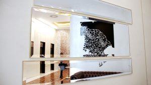arquitectura_corporativa_diseno_interiores_oficinas_recepcion_espejo_decoracion_arte