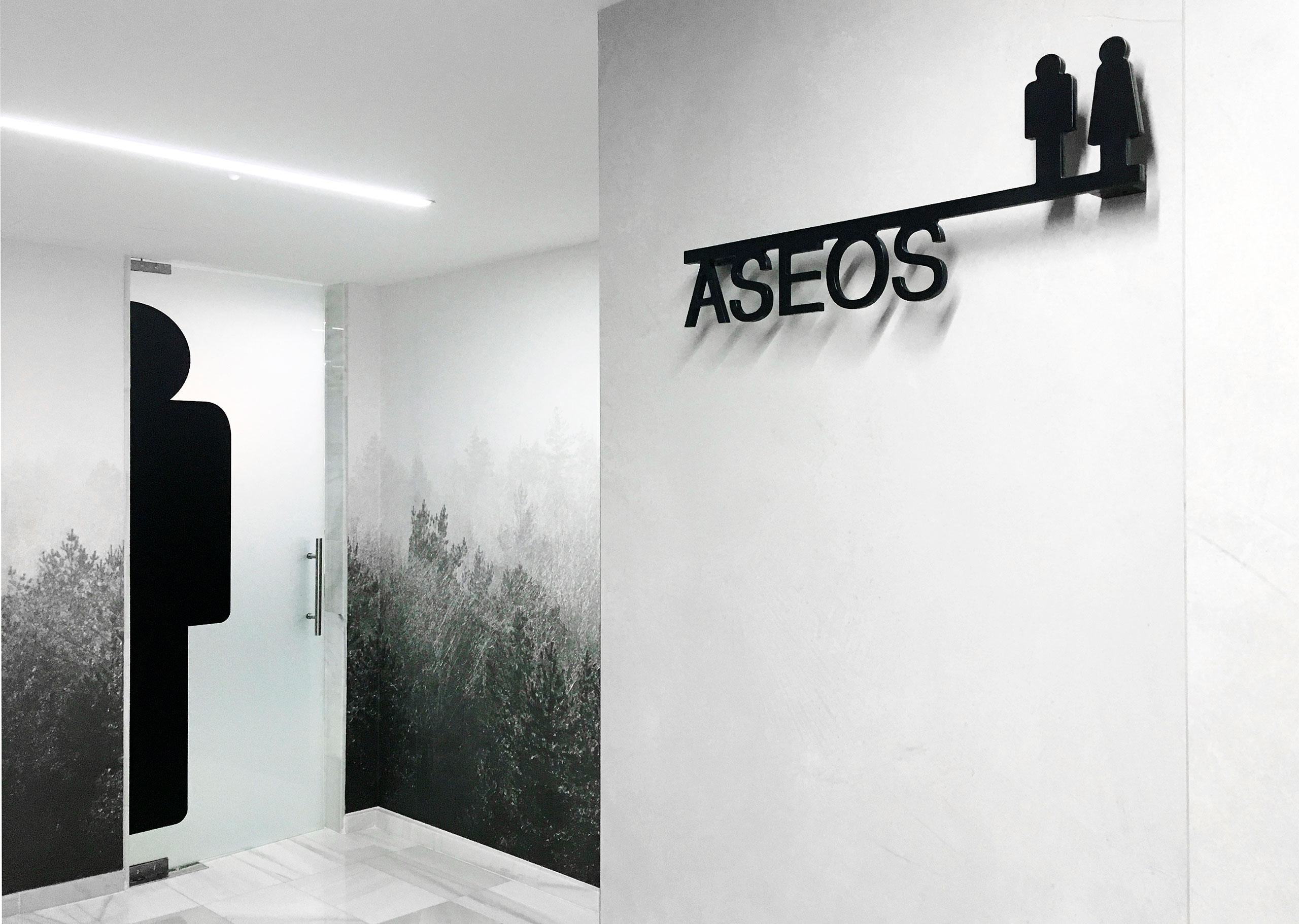 arquitectura_corporativa_diseno_wc_aseos_oficinas_senaletica_wallpaper_vegetal_plantas_papel_pintado